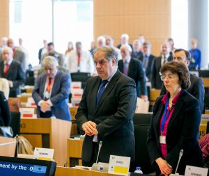 Members of the Committee of the Regions standing in tribute to victims of the Brussels attacks